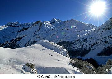 Sun shining on a mountain range