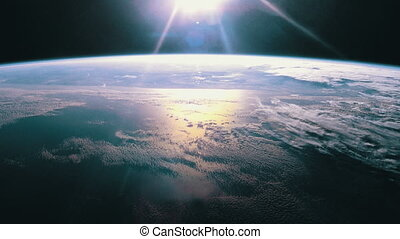 Sun shining over earth. - Space view of the sun shining over...