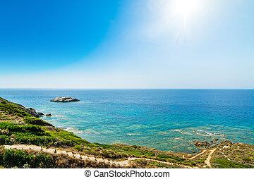 Sun shining over the shore in Sardinia