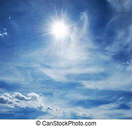 Sun shinning through moody white clouds