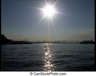SUN sparkles over the sea at port - Sun shining on the...