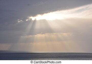 Sun through a break in the clouds