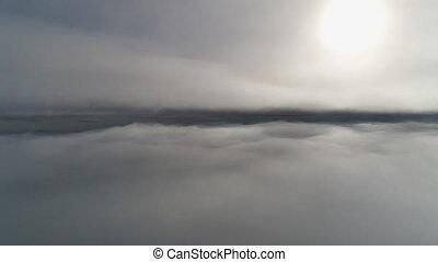 Sun through fog. Antarctica aerial drone flight. - Sun...