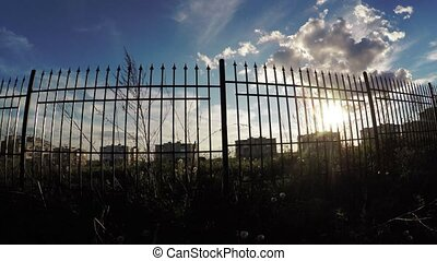Sun through the fence