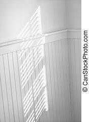 Sun through window blinds on wall. - Sun spot on wall from...