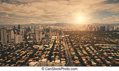 Sun town cityscape at downtown aerial. Sunlight at streets, roads with buildings. Modern skyscrapers
