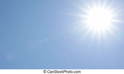 Sun traveling across clear blue sky