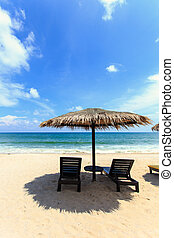 Sun umbrella and sun loungers stand at the beach in Phuket, ...