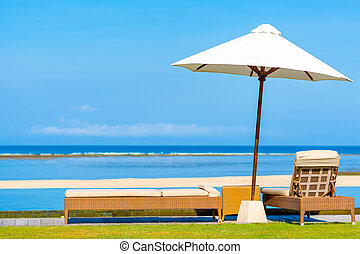 Sun umbrella & Daybeds overlooking beautiful tropical beach...