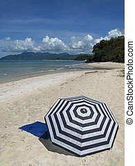 Sun umbrella on a sandy beach of Langkawi island Malyasia