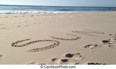Sun word in sand