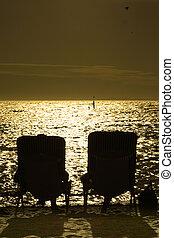Sunbake - Couple enjoying sunset