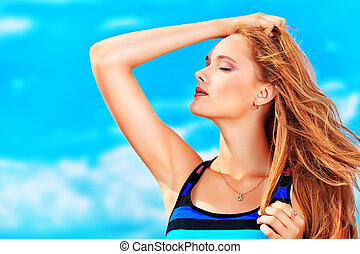sunbath - Happy young woman standing face to the wind over ...