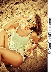 sunbathe on the beach