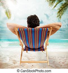 Sunbathe on the beach - Man lying on deckchair at the beach