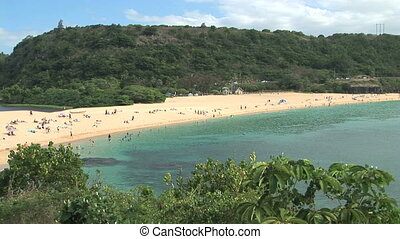 Sunbathers at Waimea Beach
