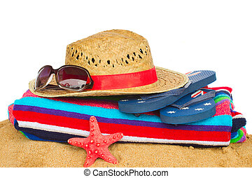 sunbathing accessories with towel on sand isolated on white background