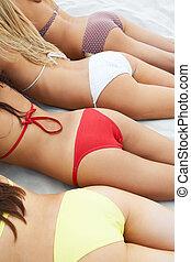 Sunbathing  - Photo of feminine bottoms sunbathing in line