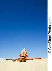 Sunbathing woman - Creative image of sunbathing woman on the...