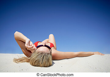 Sunbathing woman - Creative image of sunbathing woman on the...