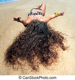 Sunbathing woman - Young beautiful woman is sunbathing on...