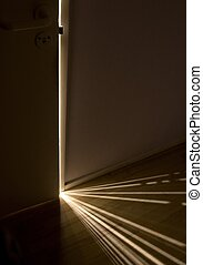 sunbeam - Sunlight shining through a small gap between the...