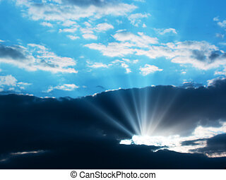 Sunbeam through the clouds - Sun shining through the clouds