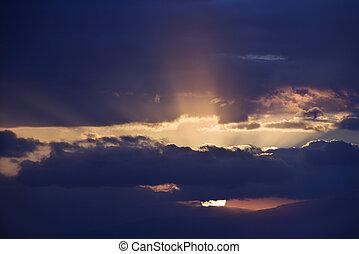 Sunbeams coming through clouds.