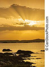 Sunbeams on the coast