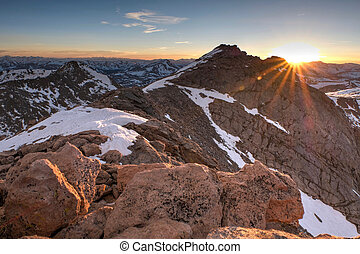 Sunbeams over rocky mountains. - Sunset. Mount Evans....