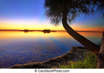 Sunbeams reflected in the water at sunset - Sunbeams...
