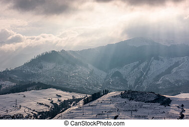 sunbeams through clouds over the snowy mountains. beautiful...