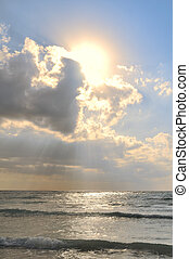 Crepuscular Rays Trough the Clouds Above the Caribbean Sea