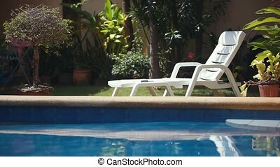 Sunbed lounger near the swimming pool. Tropical paradise. 1920x1080