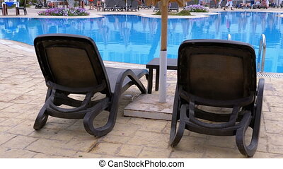 Sunbed Lounger near the Swimming Pool with Blue Water in the Resort of Egypt.