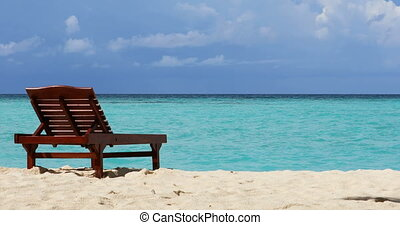 Sunbed on the Maldives Beach 4K.