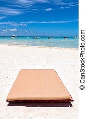 Sunbed on tropical beach in Isla Mujeres, Mexico