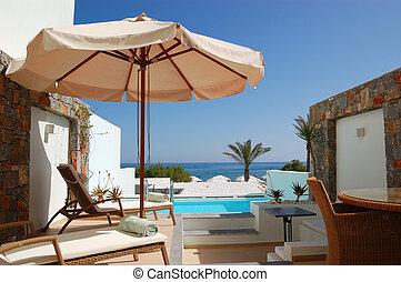 Sunbeds at the luxury villa, Crete, Greece