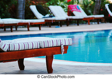 poolside - sunbeds at the poolside