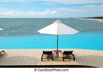 Sunbeds at the sea view swimming pool, Bentota, Sri Lanka