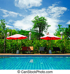 Sunbeds beside the pool