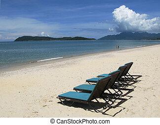 Sunbeds on a beach of Langkawi island, Malaysia