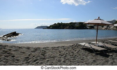 Sunbeds on beach at luxury hotel