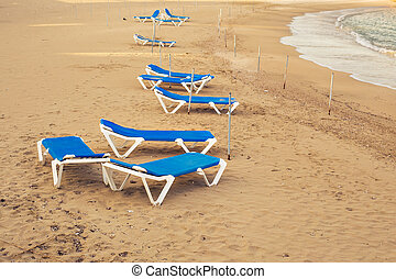 Sunbeds on the sea beach, top view