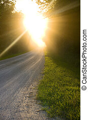 Sunburst - A sunburst along a rural path.
