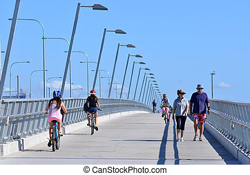 GOLD COAST, AUS - OCT 13 2014:People cross over Sundale Bridge The bridge span across the Nerang River in Southport Gold Coast Queensland Australia.