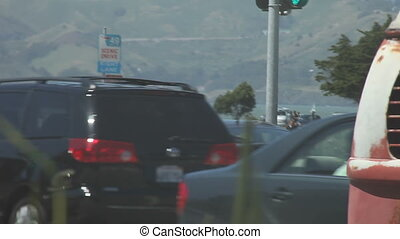 Sunday crowd near San Francisco Bay - people and cars out on...