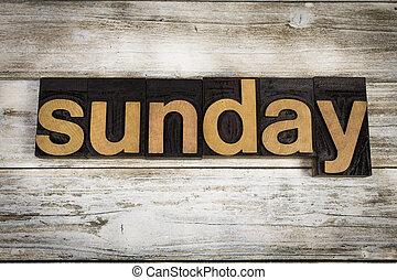 Sunday Letterpress Word on Wooden Background