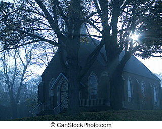 This is a shot of an old church on a foggy Sunday morning.