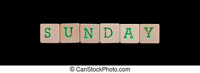 Sunday spelled out in old wooden blocks